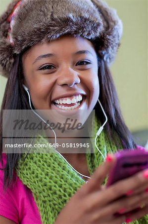 Teenage girl listening to headphones Stock Photo - Premium Royalty-Free, Image code: 649-05819945