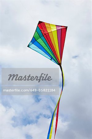 Kite flying in cloudy sky Stock Photo - Premium Royalty-Free, Image code: 649-05821184