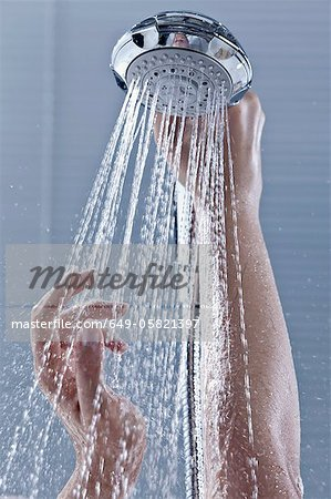 Hands holding shower head Stock Photo - Premium Royalty-Free, Image code: 649-05821397