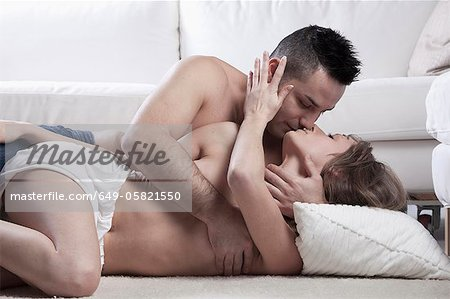 Nude couple kissing on floor Stock Photo - Premium Royalty-Free, Image code: 649-05821550