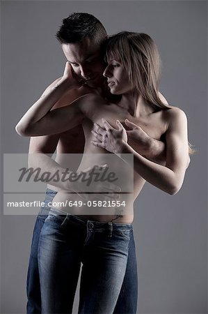 Nude couple hugging Stock Photo - Premium Royalty-Free, Image code: 649-05821554