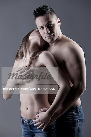 Nude couple hugging Stock Photo - Premium Royalty-Free, Image code: 649-05821556