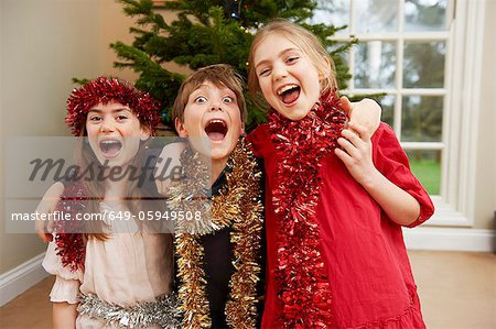 Children playing with Christmas tinsel Stock Photo - Premium Royalty-Free, Image code: 649-05949508