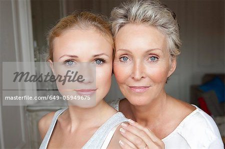 Mother and daughter smiling together Stock Photo - Premium Royalty-Free, Image code: 649-05949675