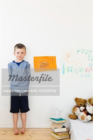 Boy with drawings on bedroom wall Stock Photo - Premium Royalty-Free, Image code: 649-05949795