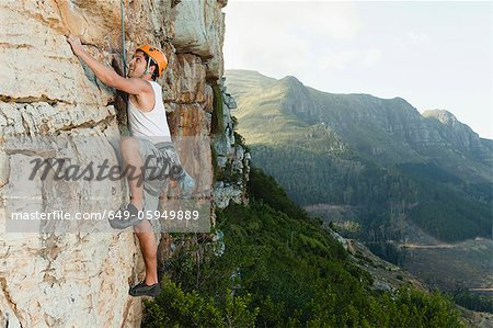 Climber scaling steep rock face Stock Photo - Premium Royalty-Free, Image code: 649-05949889