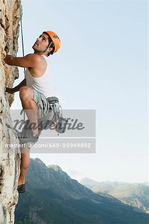 Climber scaling steep rock face Stock Photo - Premium Royalty-Free, Image code: 649-05949892