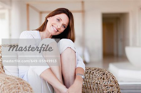 Older woman relaxing in armchair Stock Photo - Premium Royalty-Free, Image code: 649-05949913