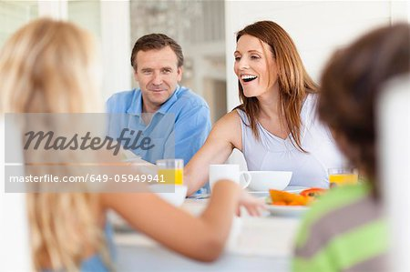 Family eating together at table Stock Photo - Premium Royalty-Free, Image code: 649-05949941
