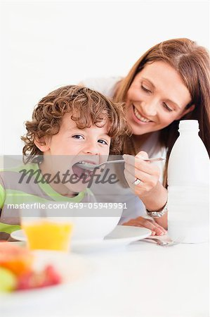 Mother feeding son cereal Stock Photo - Premium Royalty-Free, Image code: 649-05949951