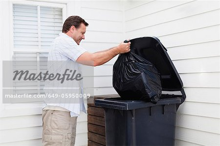 Man taking out garbage Stock Photo - Premium Royalty-Free, Image code: 649-05950009