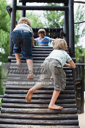Boys playing on play structure together Stock Photo - Premium Royalty-Free, Image code: 649-05950129