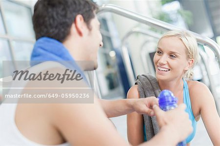 Couple talking on gym steps Stock Photo - Premium Royalty-Free, Image code: 649-05950236