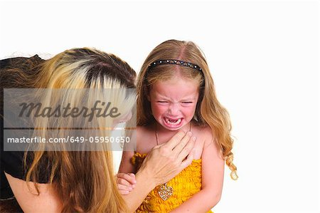 Mother comforting crying girl Stock Photo - Premium Royalty-Free, Image code: 649-05950650