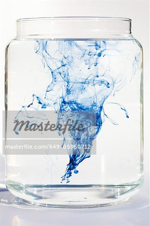 Blue liquid dissolving in water Stock Photo - Premium Royalty-Free, Image code: 649-05950712
