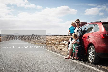 Family standing by broken down car Stock Photo - Premium Royalty-Free, Image code: 649-05950802