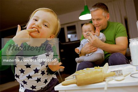 Child licking fingers while cooking Stock Photo - Premium Royalty-Free, Image code: 649-05950955