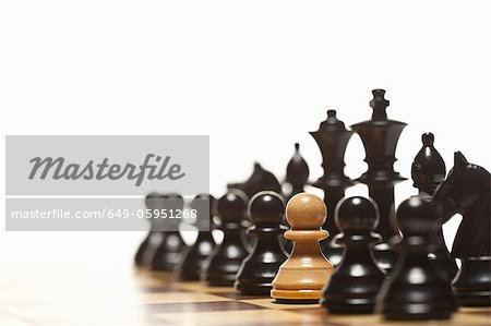 White pawn in black chess set Stock Photo - Premium Royalty-Free, Image code: 649-05951268