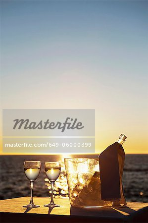 Wine glasses and bottle outdoors Stock Photo - Premium Royalty-Free, Image code: 649-06000399