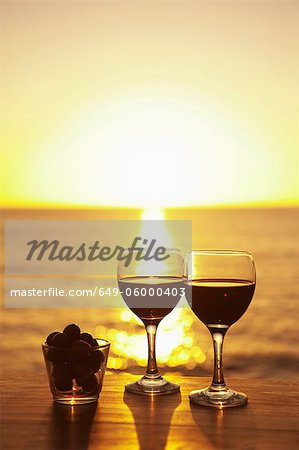 Wine glasses and grapes outdoors Stock Photo - Premium Royalty-Free, Image code: 649-06000403