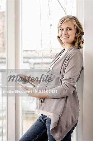 Pregnant woman using tablet computer Stock Photo - Premium Royalty-Free, Image code: 649-06000428