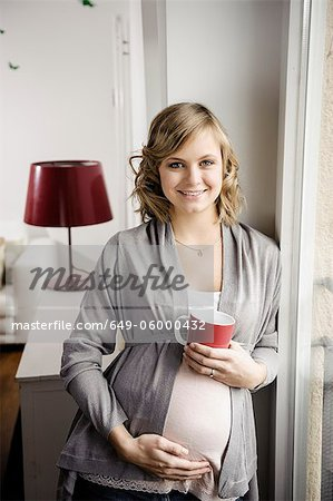 Pregnant woman having cup of coffee Stock Photo - Premium Royalty-Free, Image code: 649-06000432