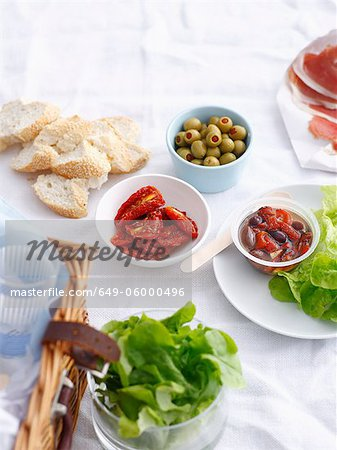 Bowls of preserves, bread ad lettuce Stock Photo - Premium Royalty-Free, Image code: 649-06000496
