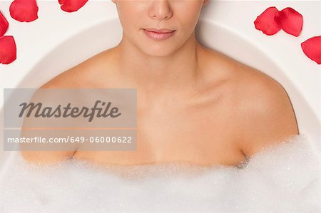 Woman relaxing in bubble bath Stock Photo - Premium Royalty-Free, Image code: 649-06000622