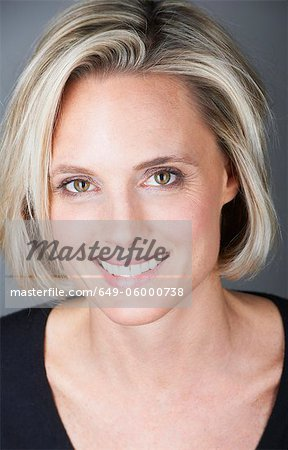 Close up of womans smiling face Stock Photo - Premium Royalty-Free, Image code: 649-06000738