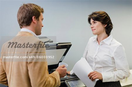 Business people talking at copier Stock Photo - Premium Royalty-Free, Image code: 649-06000952