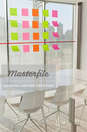 Colorful sticky notes on office window Stock Photo - Premium Royalty-Free, Image code: 649-06000968