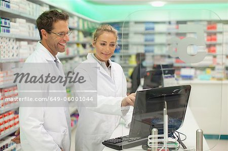 Pharmacists using computer at counter Stock Photo - Premium Royalty-Free, Image code: 649-06001044