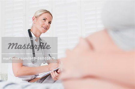 Doctor talking to pregnant woman Stock Photo - Premium Royalty-Free, Image code: 649-06001079