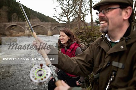 Couple fishing for salmon in river Stock Photo - Premium Royalty-Free, Image code: 649-06001368
