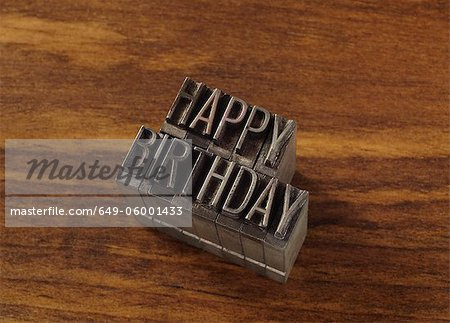 "Lead type spelling ""happy birthday"" Stock Photo - Premium Royalty-Free, Image code: 649-06001433"