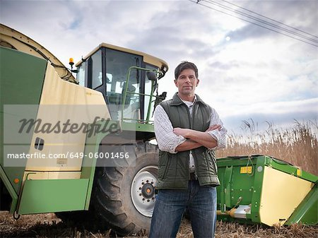 Farmer with tractor in elephant grass Stock Photo - Premium Royalty-Free, Image code: 649-06001456