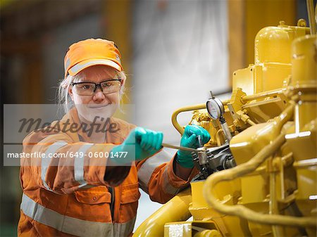 Apprentice engineer at work in factory Stock Photo - Premium Royalty-Free, Image code: 649-06001477
