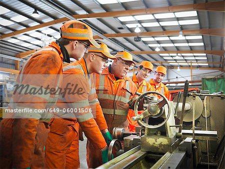 Engineer teaching apprentices in factory Stock Photo - Premium Royalty-Free, Image code: 649-06001506