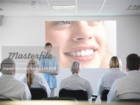 Dentist teaching students in class Stock Photo - Premium Royalty-Free, Image code: 649-06001570