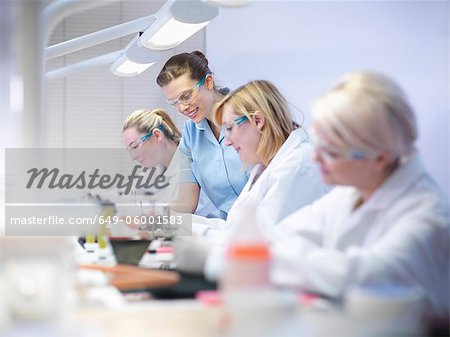 Dentist teaching students in lab Stock Photo - Premium Royalty-Free, Image code: 649-06001583