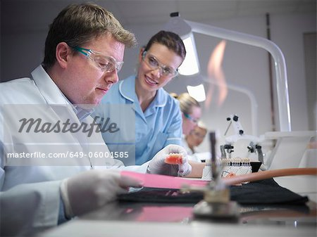 Dentist teaching students in lab Stock Photo - Premium Royalty-Free, Image code: 649-06001585