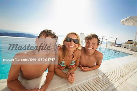 Family smiling in swimming pool Stock Photo - Premium Royalty-Free, Image code: 649-06001747