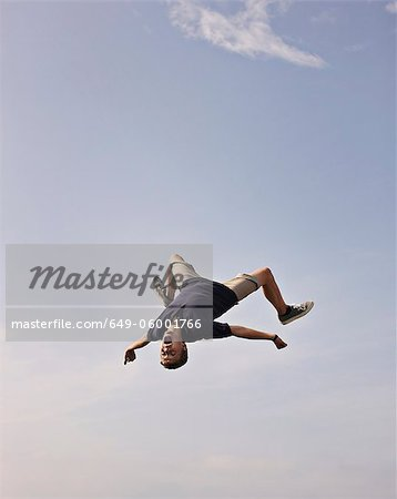 Teenage boy posing in mid-air Stock Photo - Premium Royalty-Free, Image code: 649-06001766