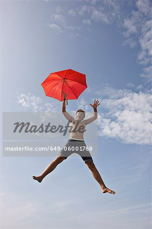 Teenage boy posing in mid-air Stock Photo - Premium Royalty-Free, Image code: 649-06001768