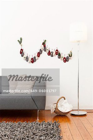Advent calendar on living room wall Stock Photo - Premium Royalty-Free, Image code: 649-06001797