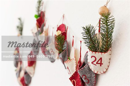 Close up of advent calendar on wall Stock Photo - Premium Royalty-Free, Image code: 649-06001798