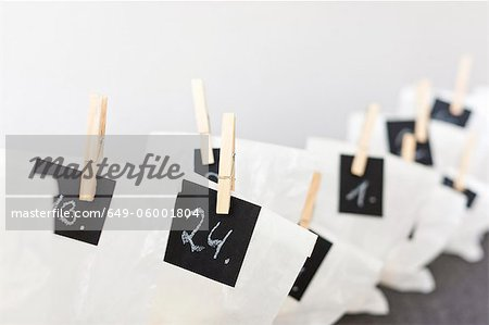 Close up of numbered bags Stock Photo - Premium Royalty-Free, Image code: 649-06001804