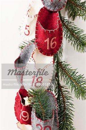 Advent calendar hanging from wall Stock Photo - Premium Royalty-Free, Image code: 649-06001805