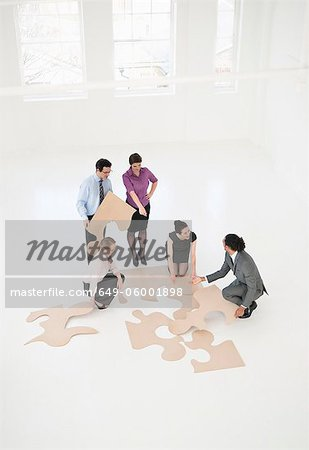 Business people doing puzzle in office Stock Photo - Premium Royalty-Free, Image code: 649-06001898