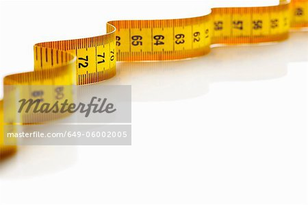 Close up of measuring tape Stock Photo - Premium Royalty-Free, Image code: 649-06002005